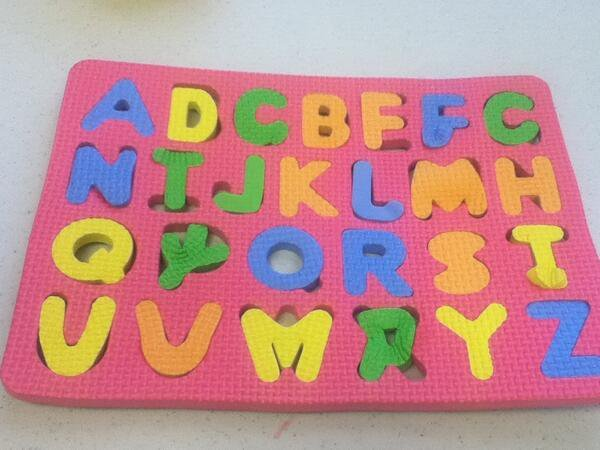 A picture of a children's alphabet toy with every letter in a wrong place