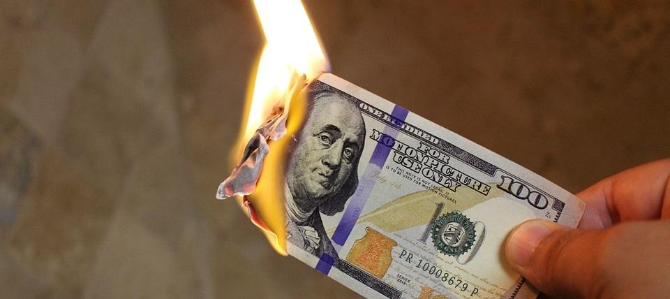 Burning US dollar bill