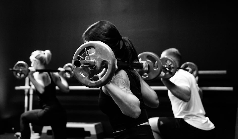Three people lifting weights