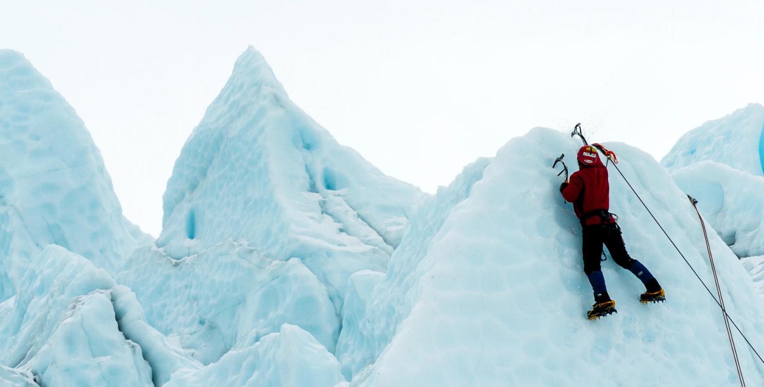 Man climbing ice wall